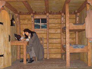Sieur de Di�reville en train d'�crire son journal de bord qu'il publia en 1708 sous le nom Relation du voyage du Port-Royal et l'Acadie ou de la Nouvelle France. Source : � Maison de cire de l'Acadie
